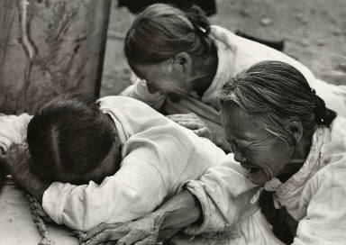 1952 - In a Korean village, a wife, mother, and grandmother lament the death of their boy in guerilla warfare