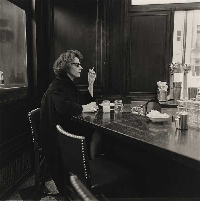 Woman at a counter smoking, N.Y.C., 1962